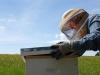 Mom checking a hive at Hardscrabble Hollow Farm, Rutherfordton, North Carolina